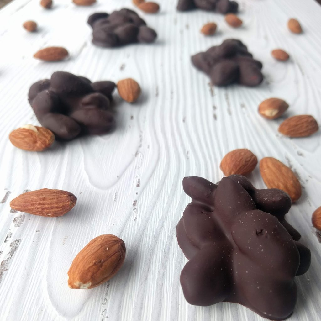 Dark chocolate almond clusters with sea salt are a delicious treat that you can make at home in minutes. Great for a gift idea, hostess gift, or just for your own chocolate indulgence.