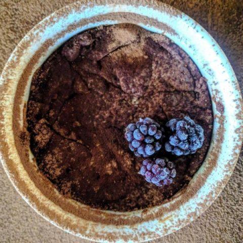 Overhead view of personal brownie in ramekin