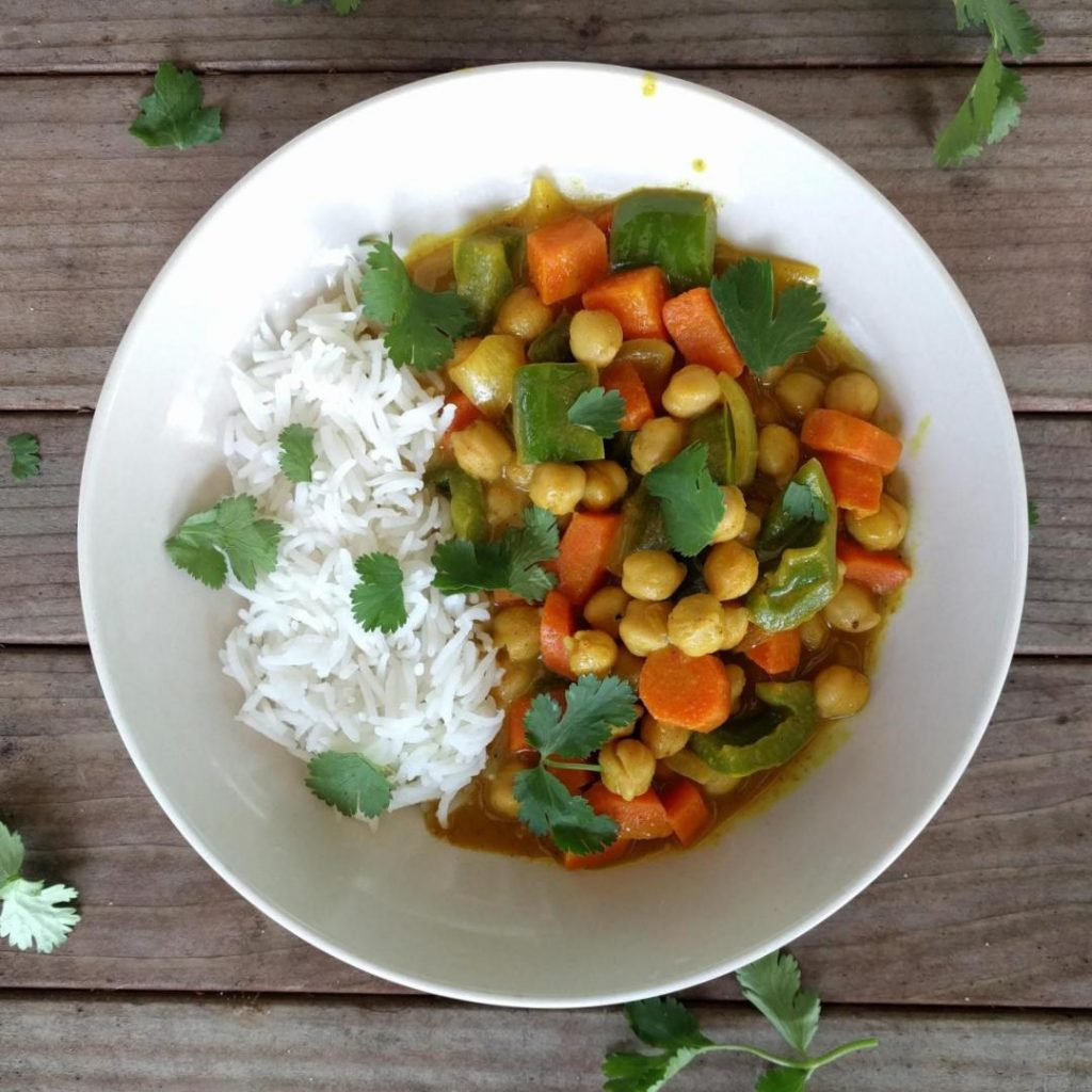 This coconut chickpea curry with turmeric is a simple and delicious weeknight meal. It comes together in 30 minutes!