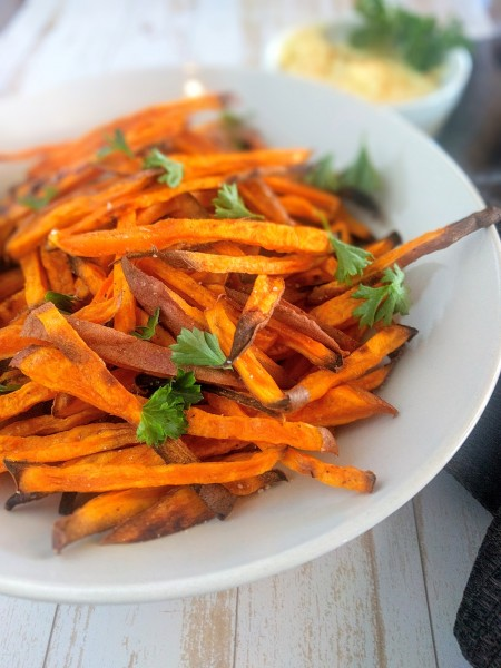 Sweet potato fries with spicy mayo in background