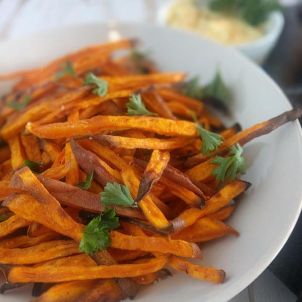 You can make these baked sweet potato fries in 30 minutes! While they're in the oven, spice up your mayo or add some herbs for a delicious dip.