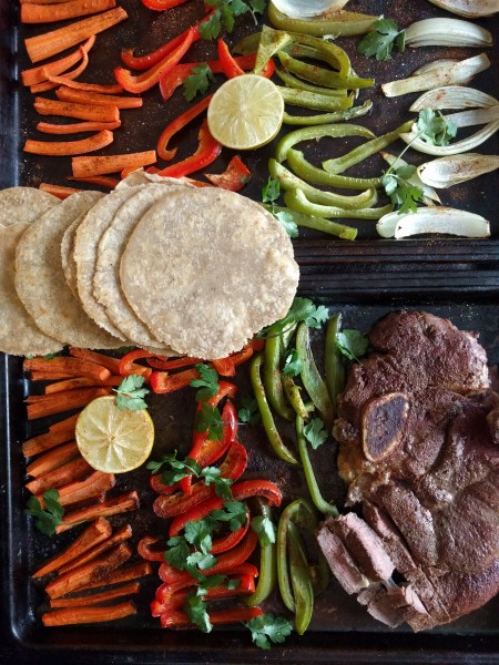 Carrots, red peppers, green peppers, onions, and steak seasoned with spices and drizzled with lime make mouthwatering fajitas! Easily cooked on a sheet pan, ready in 30 minutes!