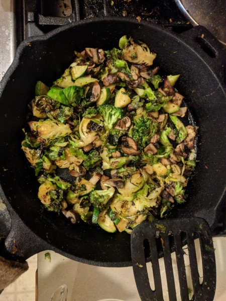 Vegetables being cooked in the cast iron