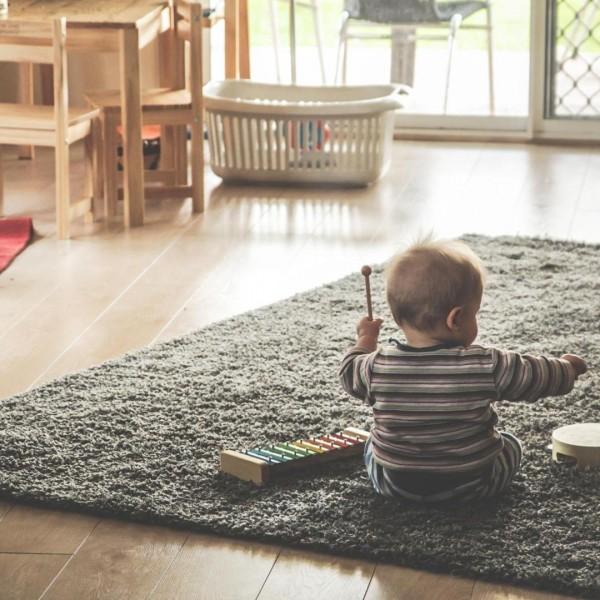 kid playing on rug