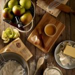 Cutting board, apples, and recipe on table