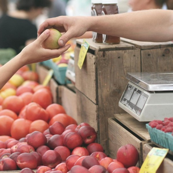 Buying fruit at farmer's market
