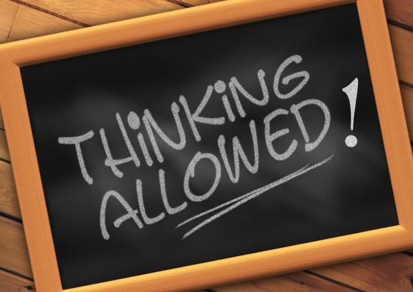 """""""Thinking allowed"""" written on chalk board"""