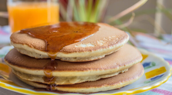 Paleo cinnamon pancakes with orange juice and a honey cinnamon glaze.