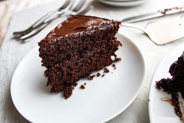 slice of Paleo chocolate cake on white plate