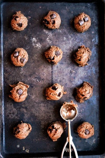 Balls of ginger cookie dough on a cookie sheet