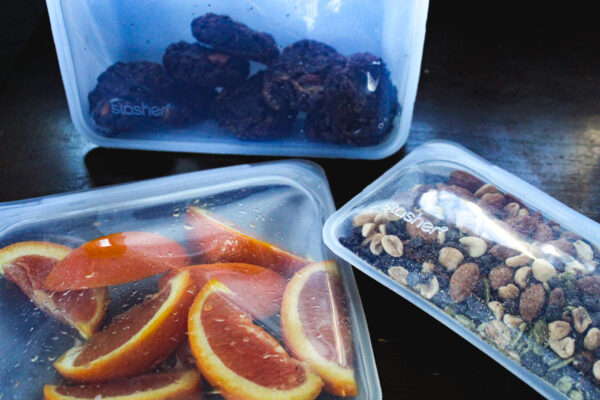 Stasher snack & sandwich bags with trail mix & oranges inside