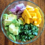 Avocado Mango salsa in glass bowl. An easy and delicious dip.