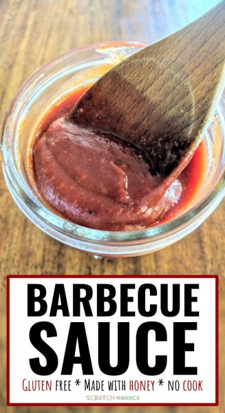 Barbecue sauce in jar with wooden spoon.