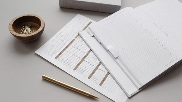 Track your food spending on a notebook or a budget template