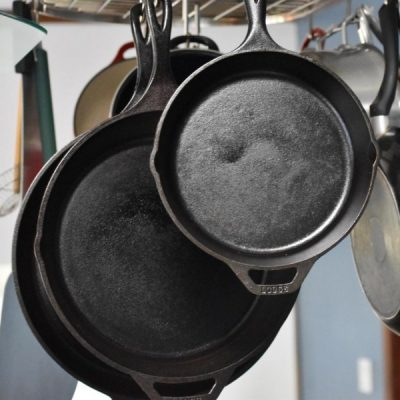 cast irons hanging in kitchen