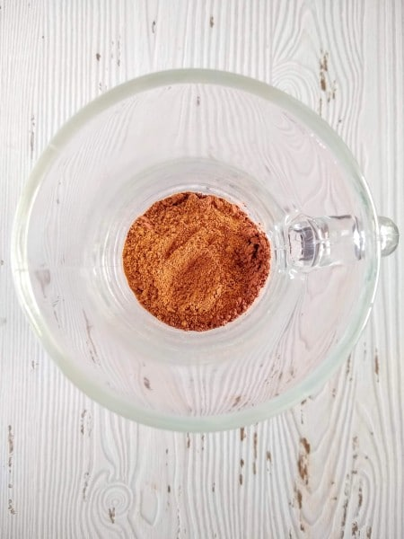 Chai spice blend scooped in mug