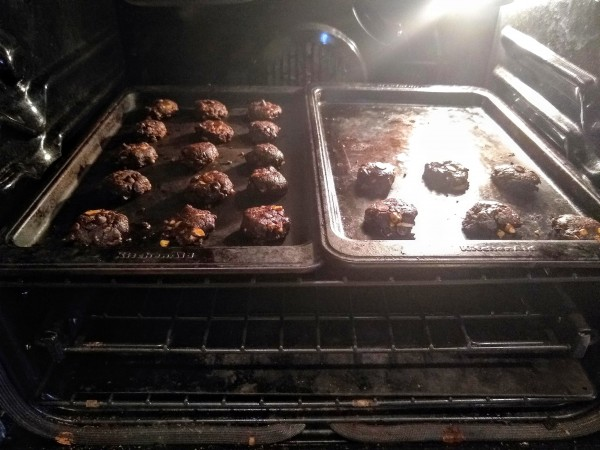 cookie sheets side by side in oven.
