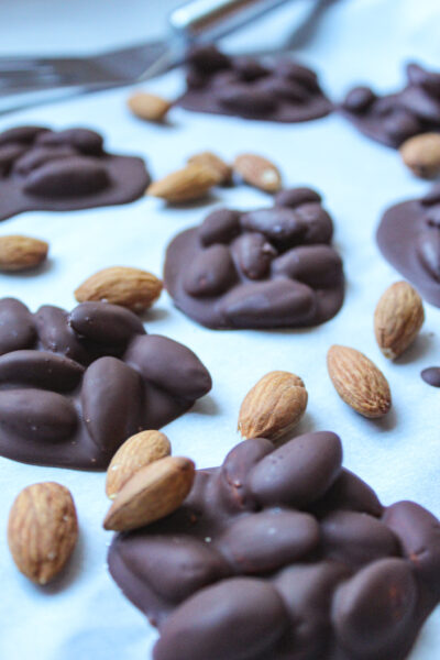 dark chocolate covered almonds on parchment paper