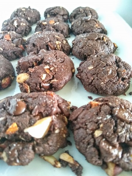 Baked flourless chocolate cookies on white plate.