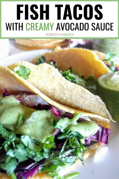 Easy fish tacos with creamy avocado sauce. A close up view.