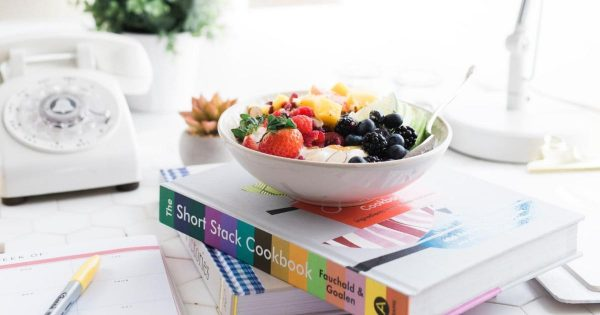 healthy bowl of food on cookbook