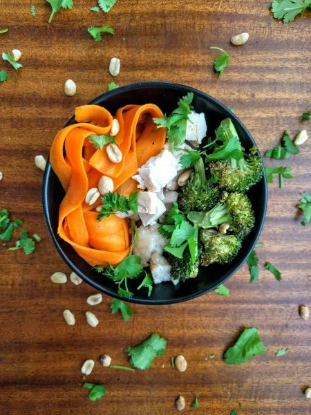 Overhead view of thai peanut bowls with carrot noodles.