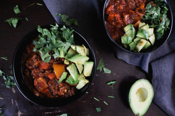 bean and bacon paleo chili in black bowls on table