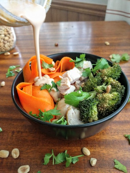 Pour the easy peanut sauce over the bowls. Then mix and enjoy!
