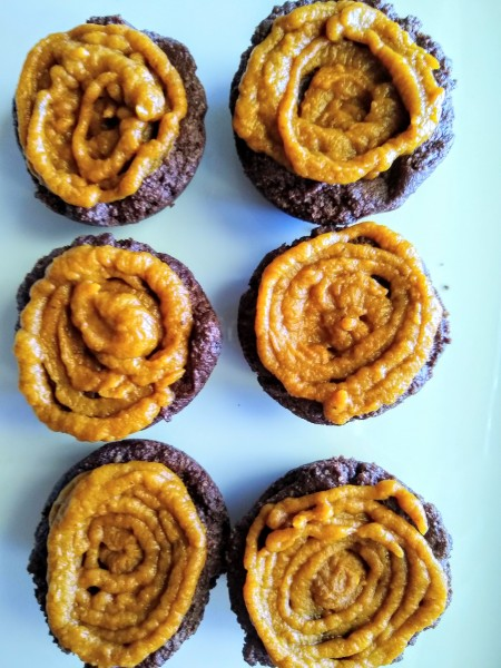 Add a layer of pumpkin spice puree to the top of the brownies before the chocolate frosting.