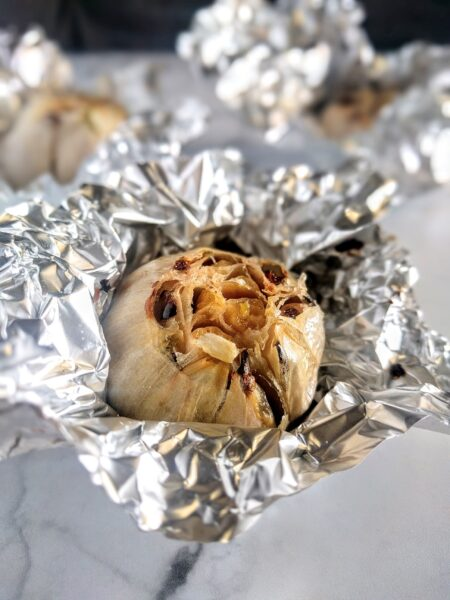 oven roasted garlic in foil fresh out of the oven.