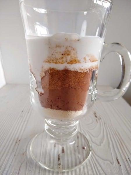 Coconut milk added to mug