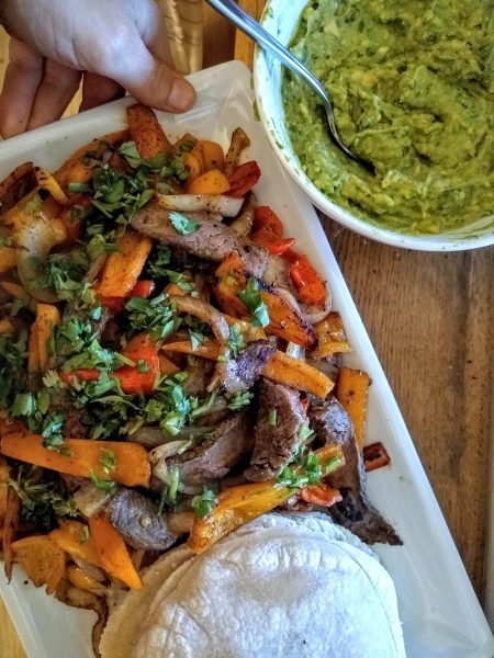 Steak fajitas with guacamole