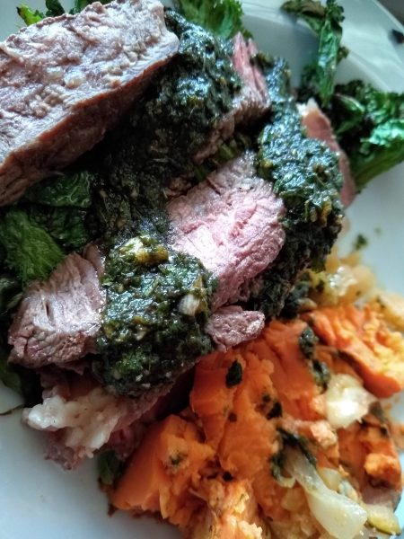 Flank steak with roasted sweet potatoes and chimichuri sauce