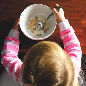 Girl eating bowl of cereal