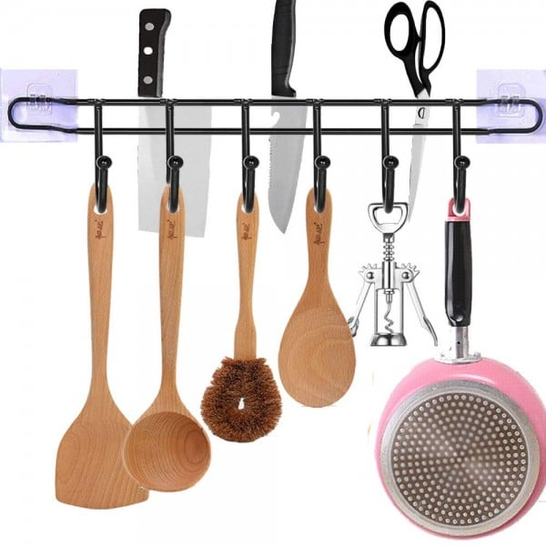 A clutter free kitchen has a place for spoons, pans, knives, and other utensils.